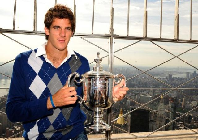EMPIRE STATE BUILDING Juan Martin Del Potro holds his US Open trophy atop of the Empire State Building in Manhattan_01_250112