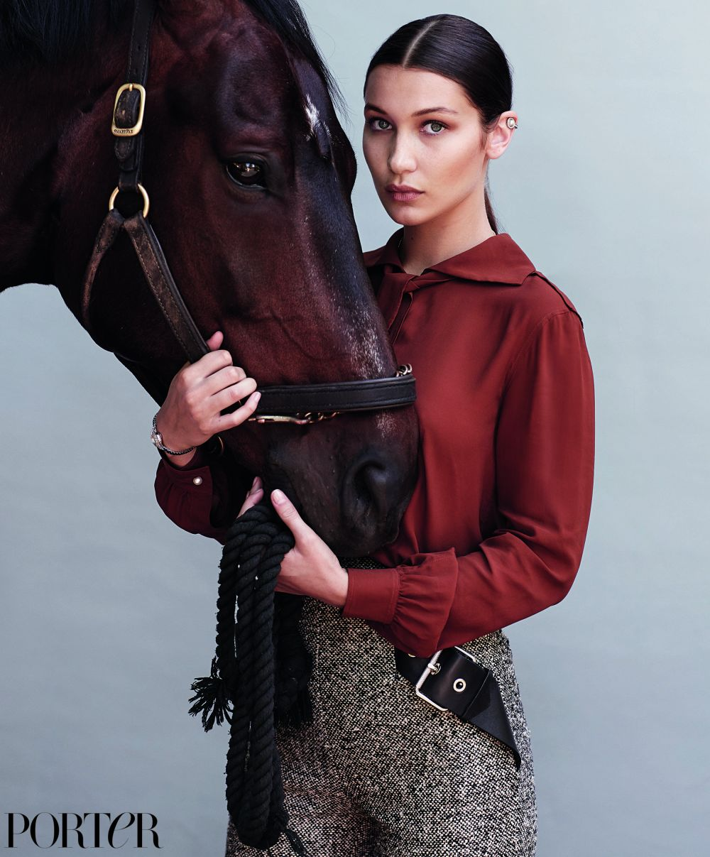 BELLA HADID wears-blouse-by-philosophy-di-lorenzo-serafini-pants-and-earrings-by-balenciaga-photographed-by-sebastian-faena-for-porter 01 190516